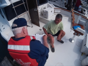 Auxiliarist giving a Vessel Exam