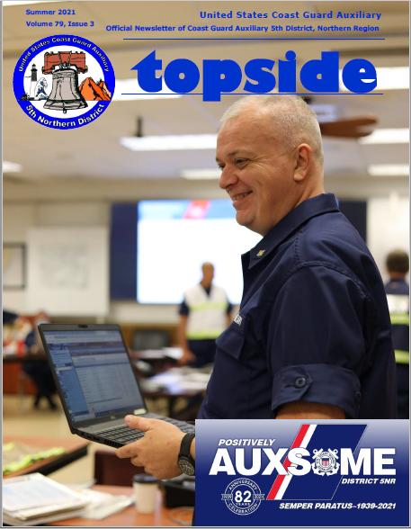 Summer Topside 2021 member holding a laptop